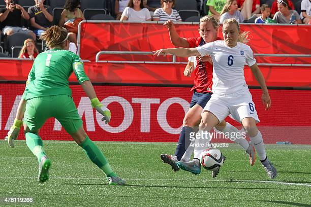 Laura Bassett and Karen Bardsley of England defend against Kristine Minde of Norway during the FIFA Women's World Cup Canada 2015 round of 16 match...