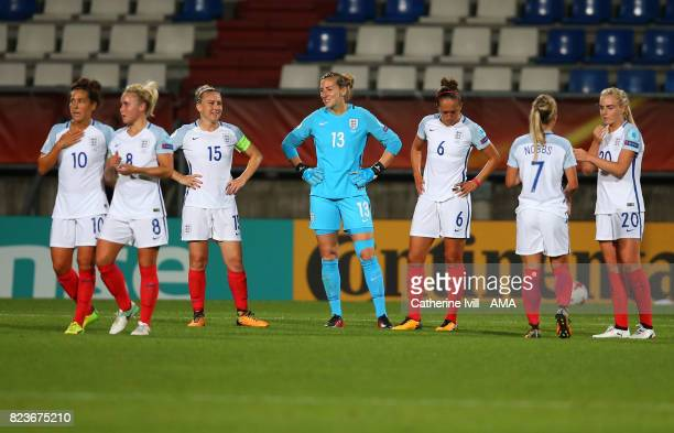 Laura Bassett and Siobhan Chamberlain of England Women stand with their team mates during the UEFA Women's Euro 2017 match between Portugal and...