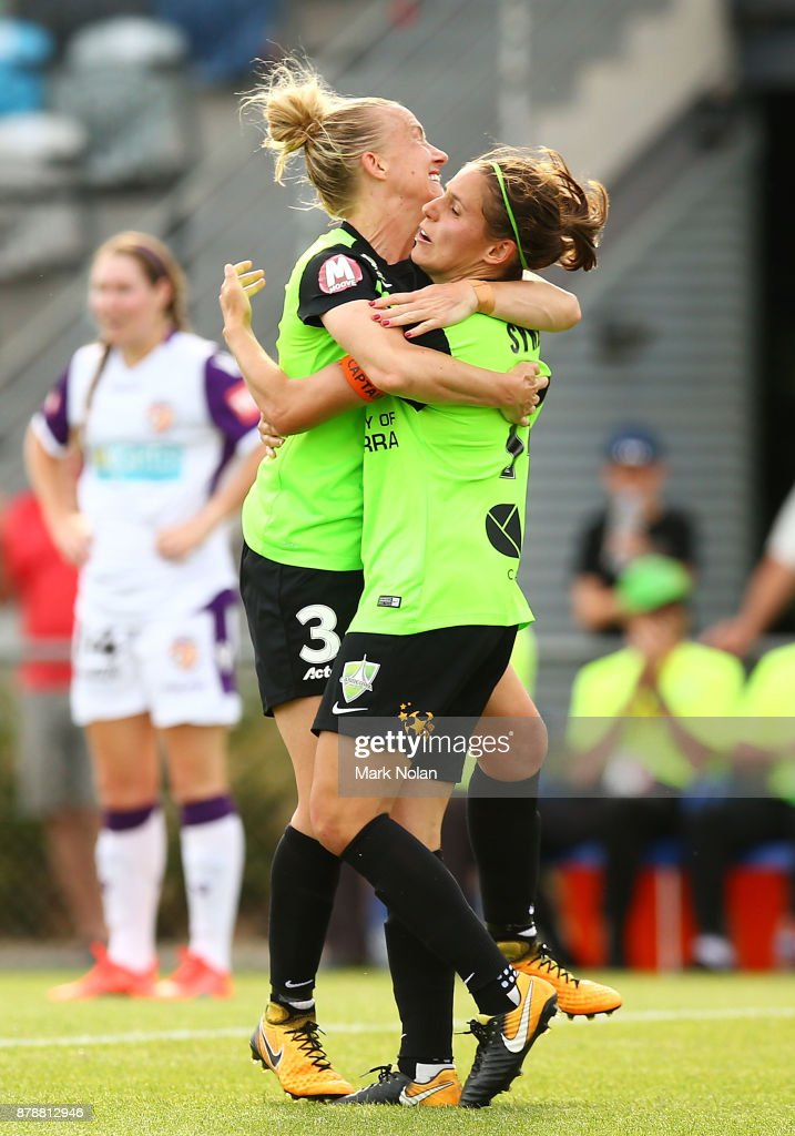 Laura Bassett of Canberra celebrates scoring a goal with team mate Ashleigh Sykes during the round five W-League match between Canberra United and Perth Glory at McKellar Park on November 25, 2017 in Canberra, Australia.