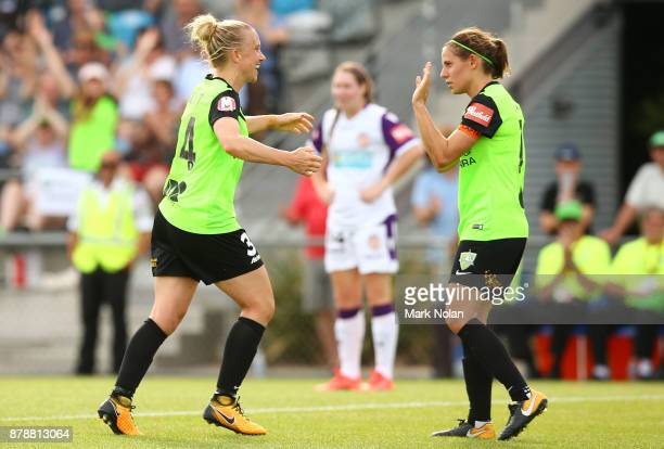 Laura Bassett of Canberra celebrates scoring a goal with team mate Ashleigh Sykes during the round five WLeague match between Canberra United and...