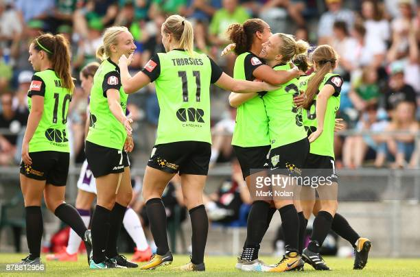 Laura Bassett of Canberra celebrates scoring a goal with team mates during the round five WLeague match between Canberra United and Perth Glory at...