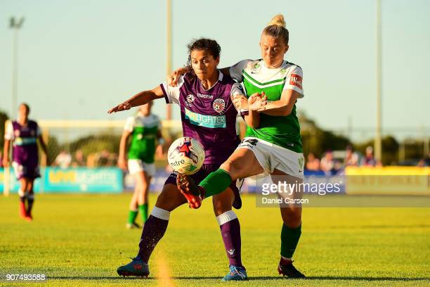 Laura Bassett of Canberra United vies for the ball over Raquel Rodrguez of Perth Glory during the round 12 WLeague match between the Perth Glory and...