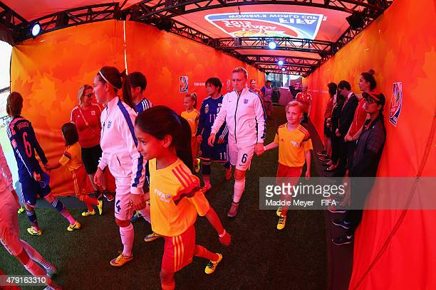 Laura Bassett of England and Fara Williams enter the pitch before the FIFA Women's World Cup Canada 2015 semi final match between England and Japan...