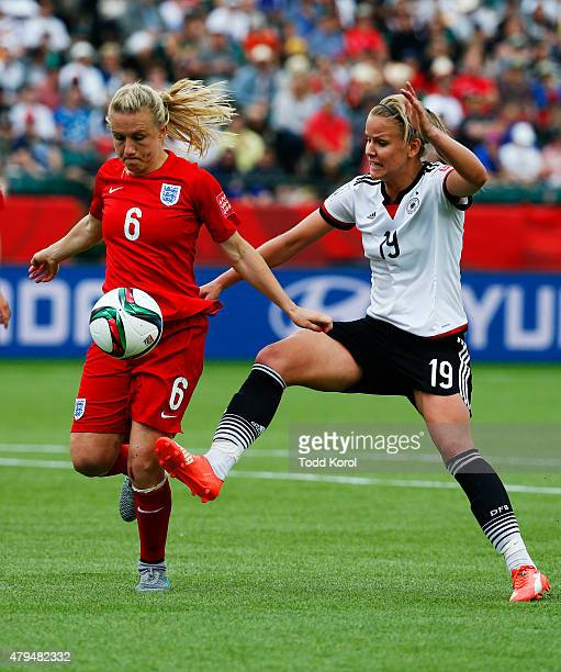 Laura Bassett of England and Lena Petermann of Germany play for the ball during the FIFA Women's World Cup Canada 3rd Place Playoff match between...