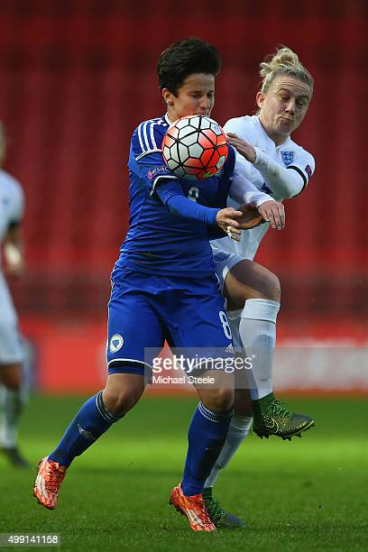 Laura Bassett of England challenges Aida Hadzic of Bosnia and Herzegovina during the UEFA Women's Euro 2017 Qualifier match between England and...