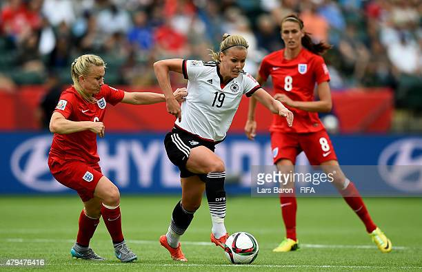 Laura Bassett of England challenges Lena Petermann of Germany during the FIFA Women's World Cup 2015 Third Place Playoff match between Germany and...