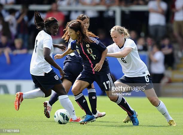 Laura Bassett of England challenges Yuki Ogimi of Japan during the England Women v Japan Women Womens' International Match at Pirelli Stadium on June...