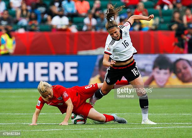Laura Bassett of England falls on the ball while Melanie Leupolz of Germany trips over her during the FIFA Women's World Cup Canada 3rd Place Playoff...