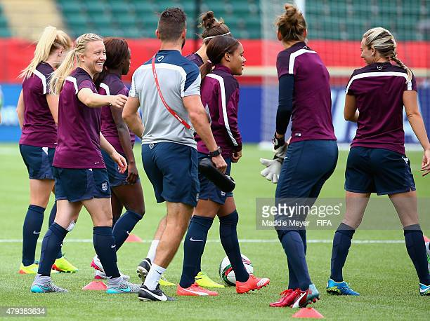 Laura Bassett of England left warms up with her team during a training session at Commonwealth Stadium on July 3 2015 in Edmonton Alberta Canada