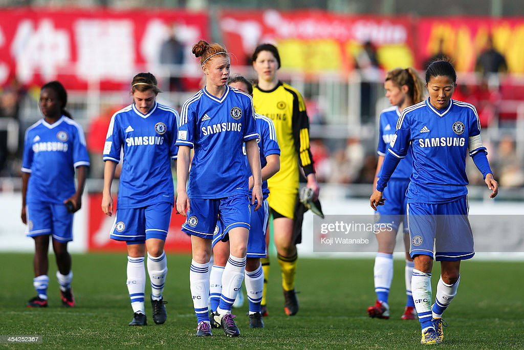 Laura Bassett#6 and Yuki Ogimi #7 of Chelsea Ladies look dejected after the International Women's Club Championship final match between Chelsea Ladies and INAC Kobe Leonessa at Ajinomoto Field Nishigaoka on December 8, 2013 in Tokyo, Japan.