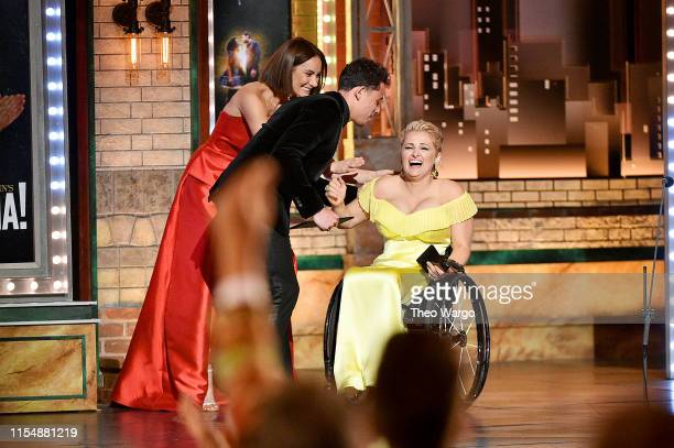 Laura Benanti and Anthony Ramos present the Best Performance by an Actress in a Featured Role in a Musical award to Ali Stroker onstage during the...