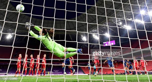 Laura Benkarth of FC Bayern Munich fails to save as Amel Majri of Olympique Lyon scores her team's second goal during the UEFA Women's Champions...