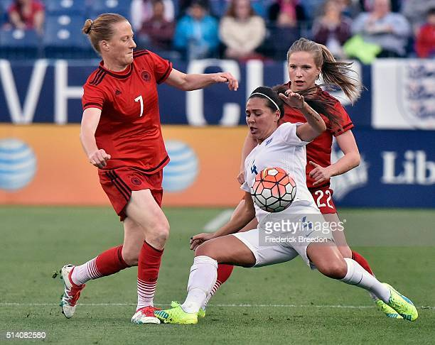 Laura Benkarth of Germany kicks the ball past Far Williams of England during the first half of a friend international match of the Shebelieves Cup at...