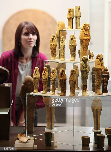 Laura Berry views mummiform figurines on display in the Ashmolean Museum's new exhibition of artifacts from ancient Egypt and Nubia on November 23...