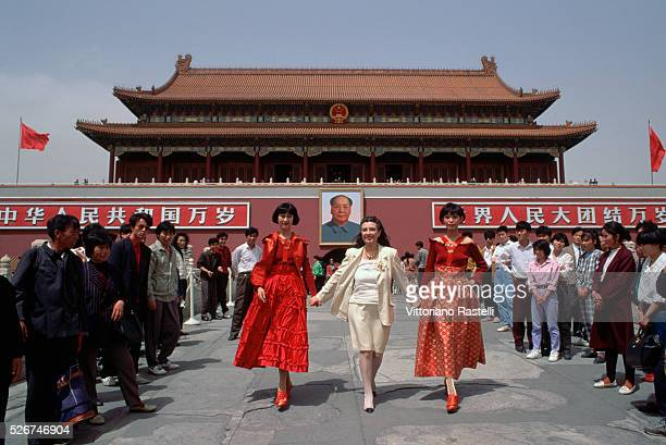 Laura Biagiotti poses with models wearing her clothes at a fashion shoot in Beijing | Location Tiananmen Sqaure Beijing China