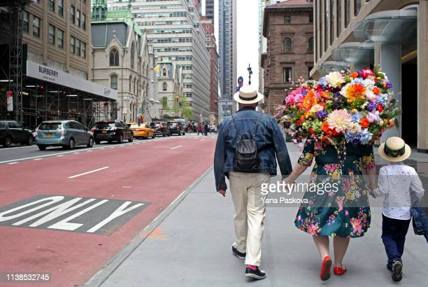 Laura Bopp wears a homemade flower hat after walking in the annual Easter Parade on April 21 2019 in New York City Each year New Yorkers put on their...