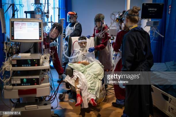 Laura Bowden Specialist Nurse, checks the Extracorporeal Membrane Oxygenation Machine, ECMO, machine before she and a team of Critical Care nurses...