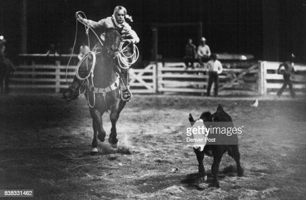 Laura Brainard of Helena Mont closes in on her torget in the junior girls calf roping competition Speed is essential in event Credit Denver Post