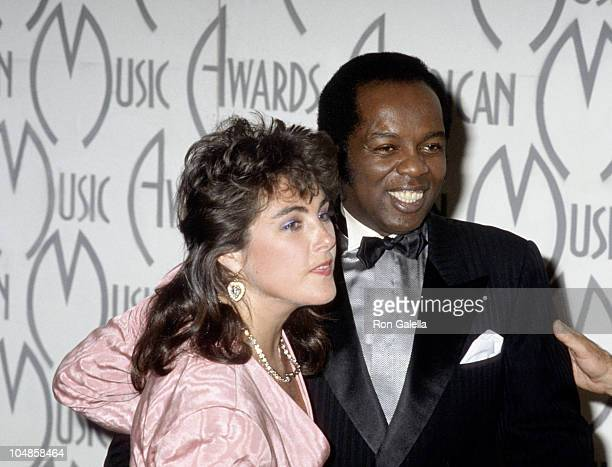 Laura Branigan and Lou Rawls during The 14th Annual American Music Awards at Shrine Auditorium in Los Angeles, California, United States.