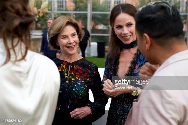 Laura Bush and Barbara Bush visit with Prabal Gurung during the Miron Crosby x Prabal Gurung Collection launch celebration at Rosewood Mansion on...