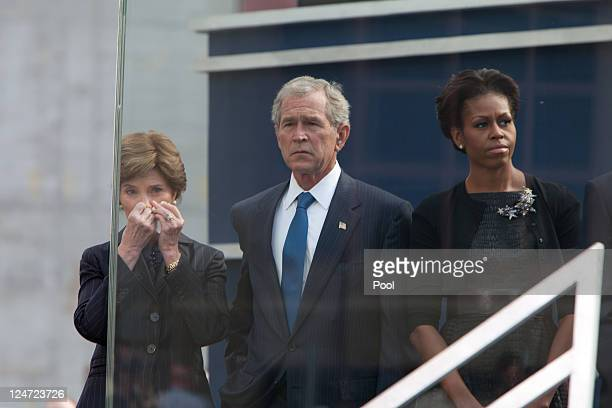 Laura Bush former President George Bush and First Lady Michelle Obama attend the 9/11 Memorial during the tenth anniversary ceremonies of the...