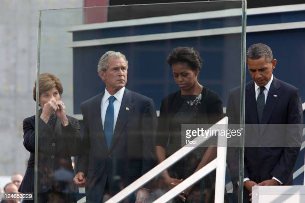 Laura Bush former President George Bush First Lady Michelle Obama and President Barack Obama attend the 9/11 Memorial during the tenth anniversary...
