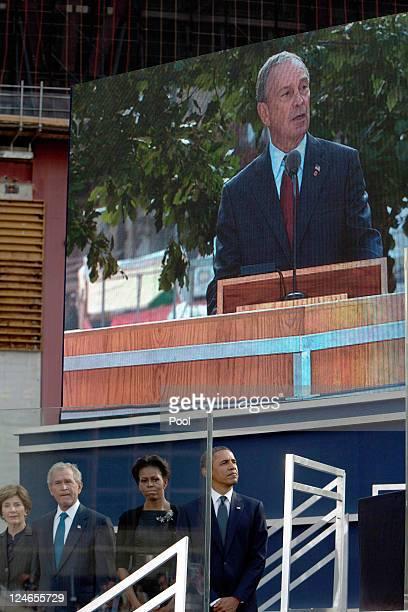 Laura Bush former President George Bush First Lady Michelle Obama and President Barack Obama listen as Mayor of New York Michael Bloomberg speaks at...