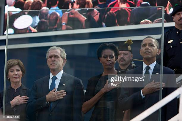 Laura Bush former President George Bush First Lady Michelle Obama and President Barack Obama salute at the 9/11 Memorial during the tenth anniversary...