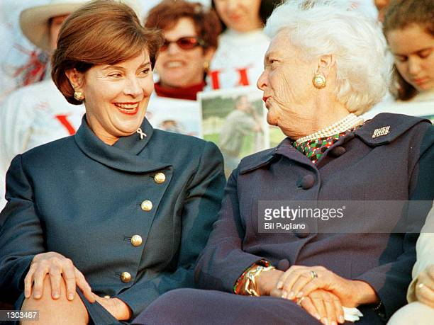 Laura Bush left and Barbara Bush chat at a W Stands For Women rally to help support the Republican ticket October 18 2000 in Southfield MI