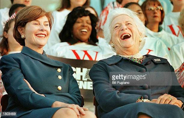 Laura Bush left and Barbara Bush enjoy a speaker''s comment at a W Stands For Women rally to help support the Republican ticket October 18 2000 in...