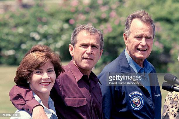 Laura Bush Texas Governor George W Bush and former US President George HW Bush meet the press at Walkers Point the President's summer home June 13...