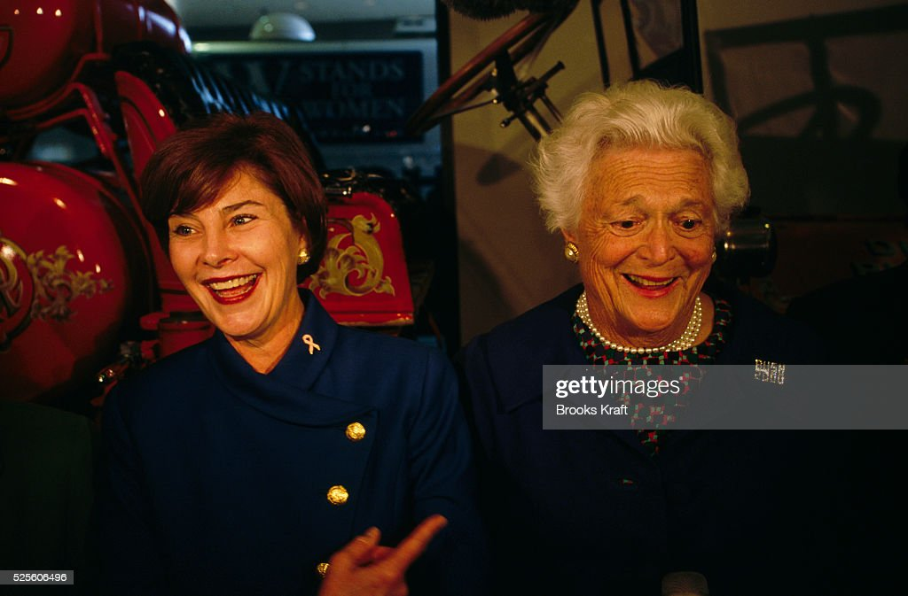 Laura Bush, wife of George W. Bush, and Barbara Bush, wife of George Bush, at a campaign rally. They were attending a 'W. Stands For Women' rally for the Presidential campaign of their respective husband and son George W. Bush.