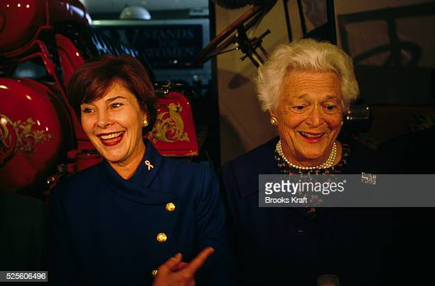 """Laura Bush, wife of George W. Bush, and Barbara Bush, wife of George Bush, at a campaign rally. They were attending a """"W. Stands For Women"""" rally for..."""