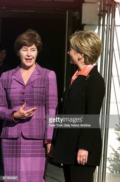 Laura Bush wife of Presidentelect George Bush and Hillary Rodham Clinton chat at the South Portico of the White HouseThe present First Lady took her...