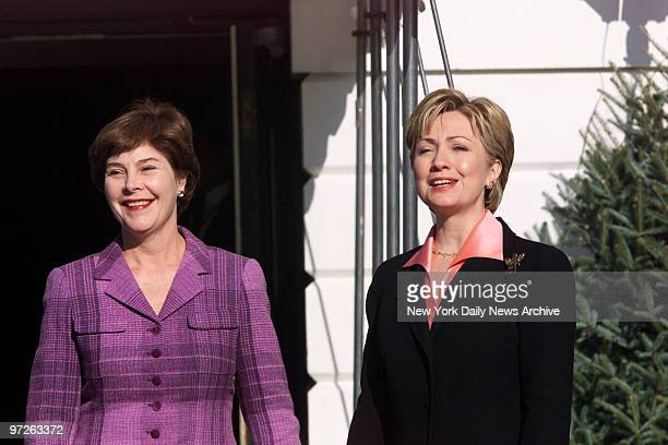 Laura Bush wife of Presidentelect George Bush and Hillary Rodham Clinton meet at the South Portico of the White HouseThe present First Lady took her...
