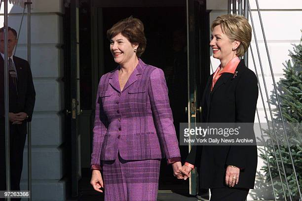 Laura Bush wife of Presidentelect George Bush and Hillary Rodham Clinton hold hands at the South Portico of the White HouseThe present First Lady...