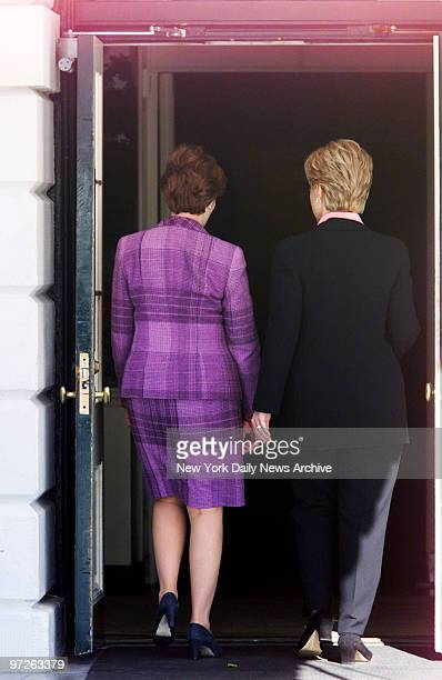Laura Bush wife of Presidentelect George Bush and Hillary Rodham Clinton walk sidebyside into the White HouseThe present First Lady took her...
