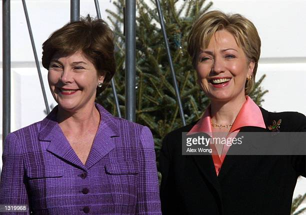 Laura Bush wife of the presidentelect George W Bush poses for photographers with first lady Hillary Rodham Clinton upon her arrival at the White...