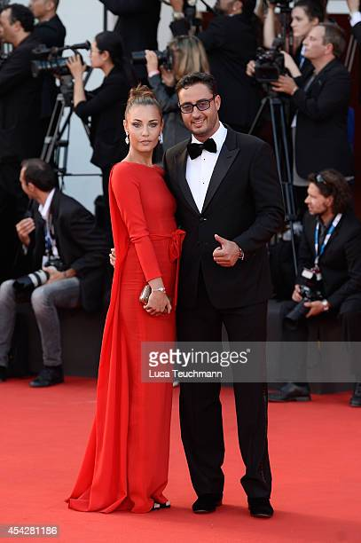 Laura Calvo and Lorenzo Tonetti attend the Opening Ceremony and 'Birdman' premiere during the 71st Venice Film Festival at Palazzo Del Cinema on...
