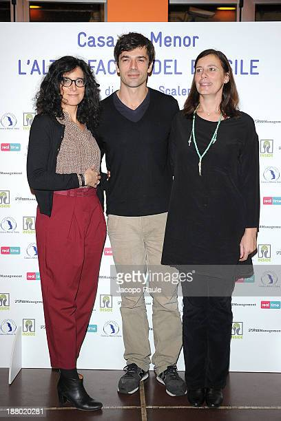 Laura Carafoli Luca Argentero and Marinella Soldi attend 'Casa Do Menor L'altra Faccia Del Brasile' Milan Photocall on November 14 2013 in Milan Italy