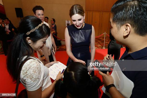 Laura Carmichael greets fans during the Downtown Abbey The Exhibition Red Carpet at the Sands Expo and Convention Centre on June 21 2017 in Singapore