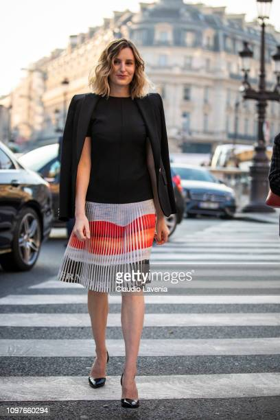 Laura Carmichael wearing a black top colorful mini skirt black blazer and black heels is seen outside Schiaparelli during Paris Fashion Week Haute...