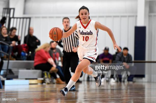 Laura Carrasco of the Robert Morris Colonials brings the ball up court in the second half during the game against the Monmouth Hawks at North...