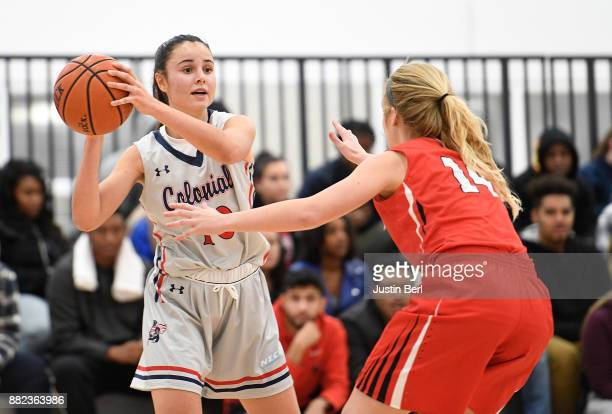 Laura Carrasco of the Robert Morris Colonials handles the ball against Melinda Trimmer of the Youngstown State Penguins in the second half during the...