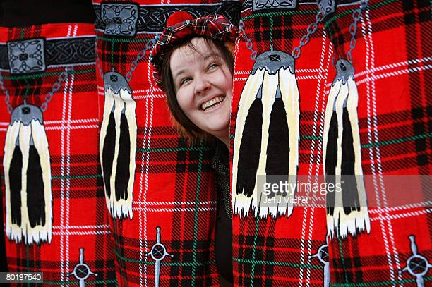 Laura Carson of Thistle Products poses with staff members wearing novelty beach kilt towels and See You Jimmy hats March 11 2008 in Dalbeattie...