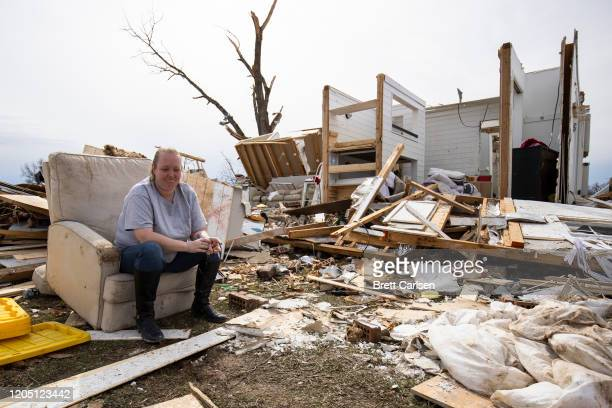 Laura Cercone of Cookeville takes a break from cleaning her friend's home where all family members survived the tornado with minor or no injuries on...