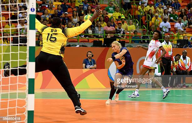 Laura Chipper of Romaina sores during the Women's Handball match between Romania and Angola on Day 1 of the Rio 2016 Olympic Games at Future Arena on...