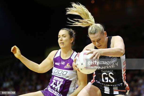Laura Clemesha of the Firebirds and Caitlin Thwaites of the Magpies copete for the ball during the round two Super Netball match between the...