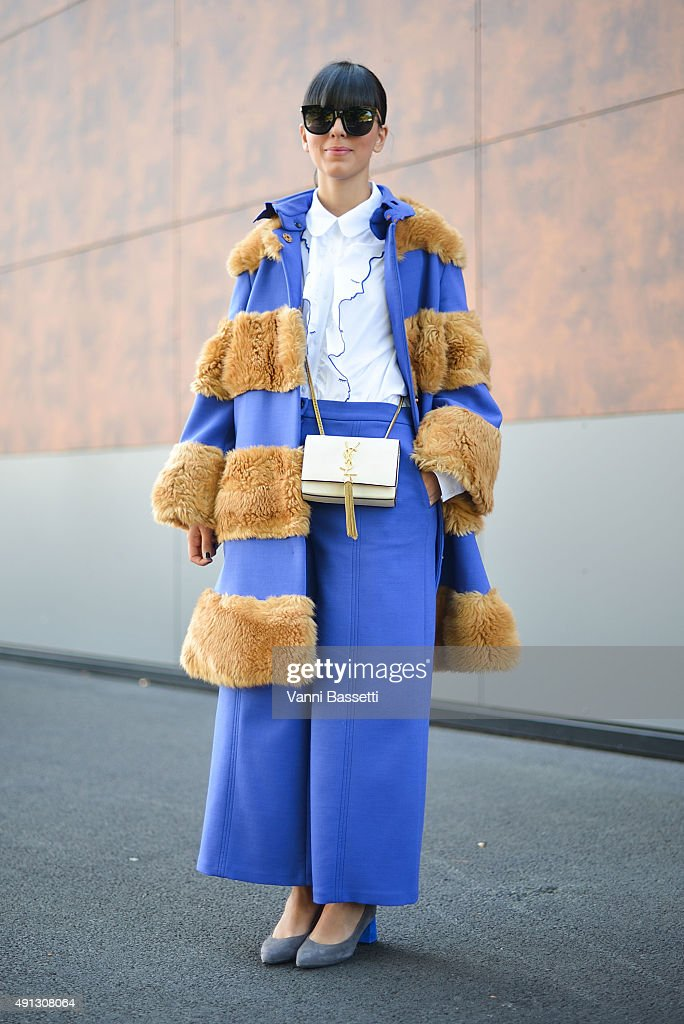 Laura Comolli poses wearing a Vivetta total look and YSL bag after the Kenzo show at the Paris Event Center during Paris Fashion Week SS16 on October 4, 2015 in Paris, France.