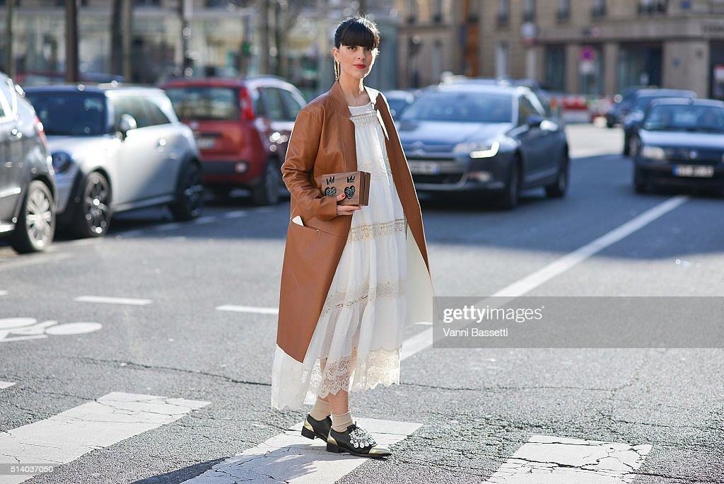 Laura Comolli poses wearing an Erica Cavallini coat and Gedebe shoes after the Celine show at the Tennis Club de Paris show during Paris Fashion Week FW 16/17 on March 6, 2016 in Paris, France.